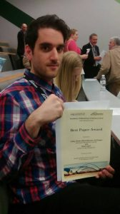Nikos Ntounis shows off our best paper prize at this year's AM conference